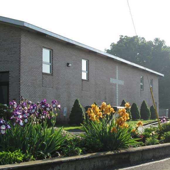 Side of church and beautiful landscape flowers